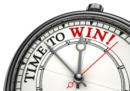 time to win concept clock closeup on white background with red and black words photo