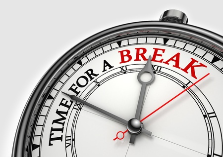 time fora break concept clock closeup on white background with red and black words photo