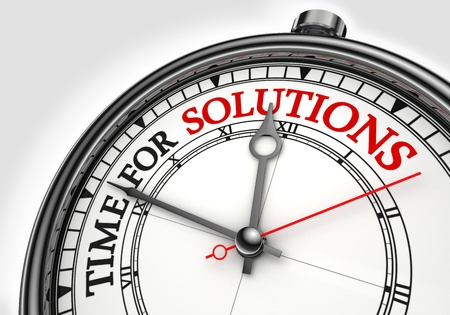 time for solutions concept clock closeup on white background with red and black words photo