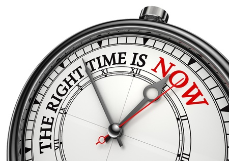 time change: now the right time concept clock closeup on white background with red and black words Stock Photo