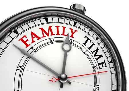 time of the day: family time concept clock closeup isolated on white background with red and black words Stock Photo
