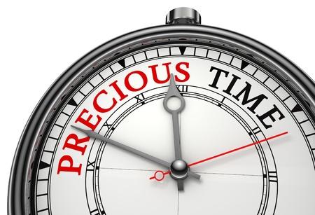 zeitarbeit: kostbare Zeit concept clock Nahaufnahme auf wei�em Hintergrund mit roten und schwarzen Worten isoliert