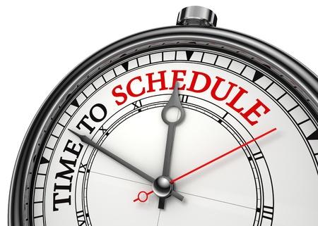 productividad: tiempo para programar primer plano el concepto de reloj aislado en fondo blanco con letras en rojo y negro Foto de archivo