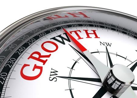 groei rood woord op concept kompas op witte achtergrond Stockfoto