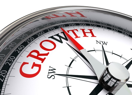grow money: growth red word on concept compass on white background