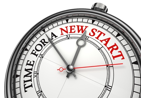 fresh start: time for a new start concept clock closeup on white background with red and black words