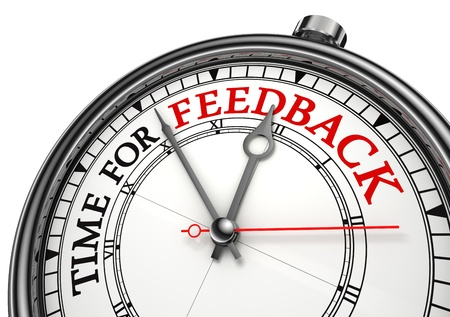 survey: time for feedback concept clock on white background with red and black words