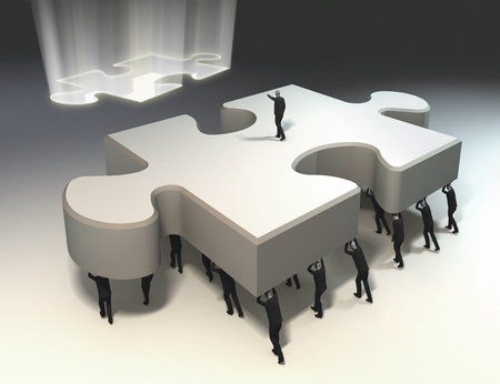 symbols metaphors: team of people with leader carrying puzzle piece in position. solution found