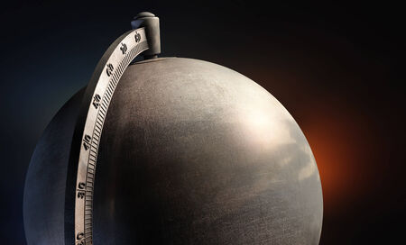 emty metal desktop globe close up on dark background photo