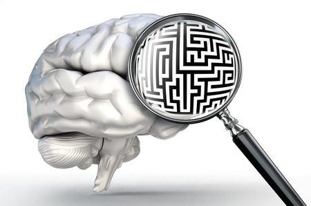 maze probleml on magnifying glass and human brain on white background photo