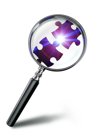 technology symbols metaphors: puzzle connection concept with magnifying glass on white background. clipping path included Stock Photo