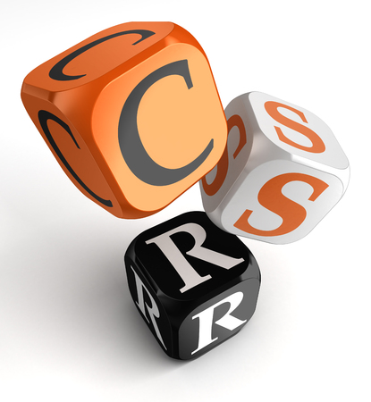 corporate responsibility: csr acronym for corporate social responsibility orange black dice blocks on white background