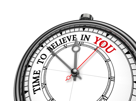 beliefs: Believe in yourself motivation metaphor on concept clock, isolated on white background