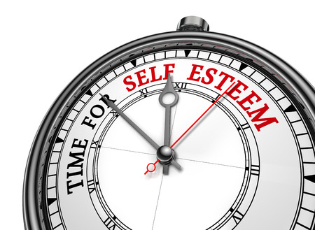 low self esteem: Self esteem time motivation message on concept clock, isolated on white background Stock Photo