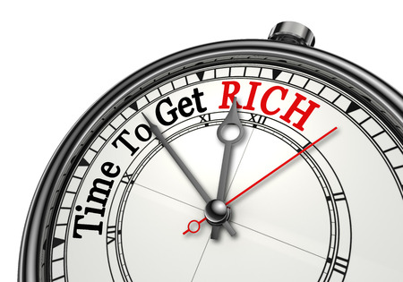 free image: Time to get rich motivation message on concept clock, isolated on white background Stock Photo