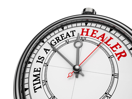 healer: Time is a great healer red wisdom on concept clock, isolated on white background