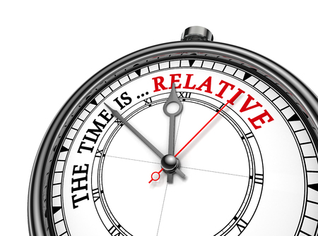 relative: Time is relative metaphor message on concept clock, isolated on white background Stock Photo