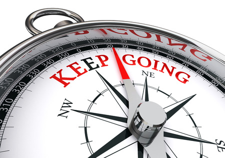 going: Keep going motivation words on compass, isolated on white background