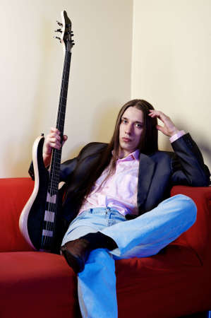 Portrait of musician with bass guitar photo