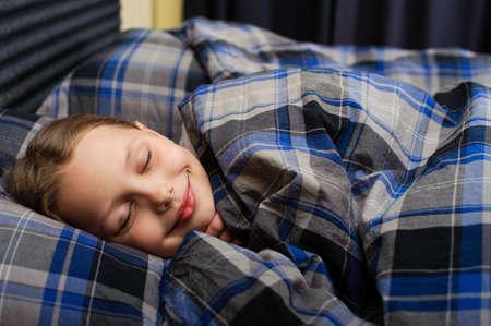 Cute litle girl. Sleeping in bed.