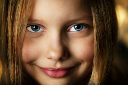 Closeup portrait of attractive smiling little girl. Shallow DOF Zdjęcie Seryjne