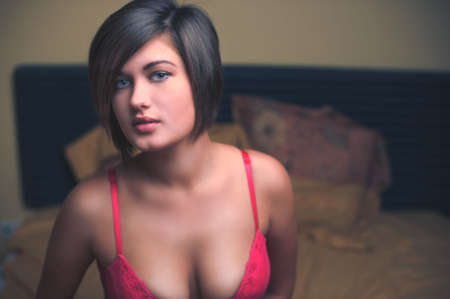 Sensual portrait of sexy young woman in pink bra photo
