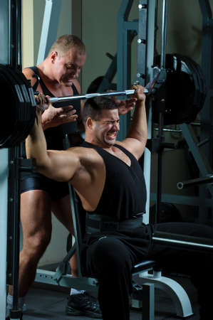 Two bodybuilders training in gym Stock Photo - 8203906