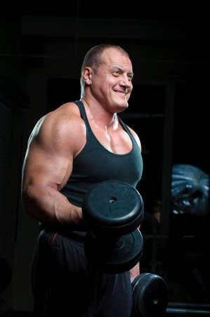 Bodybuilder training in gym  photo