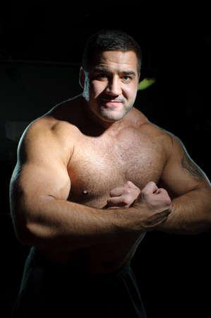 Bodybuilder training hard in gym photo
