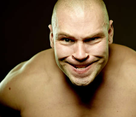 Emotional portrait of muscular aggressive man Stock Photo - 8397282