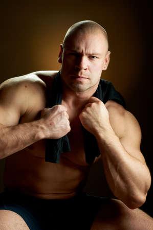contrasty: Muscular man, contrasty studio portrait