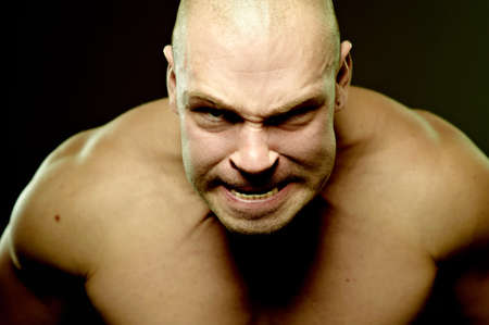 Emotional portrait of muscular aggressive man Stock Photo - 8397479