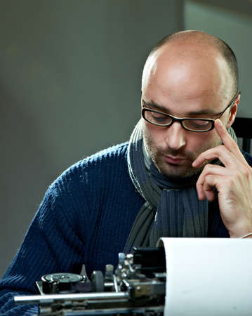 Portrait of a bald serious man in glasses Stock Photo - 8470684
