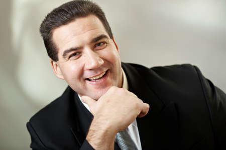 Portrait of attractive businessman in blacksuit