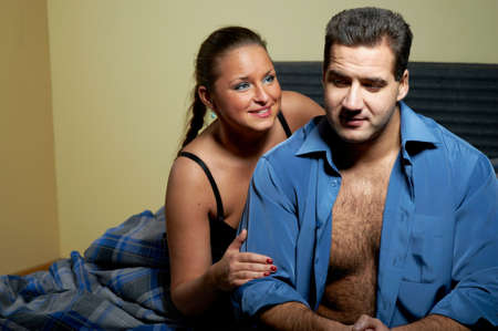 Young couple having relationship problems, in bedroom photo