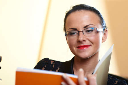 Young pretty writer woman with orange book in hands Stock Photo - 8568902