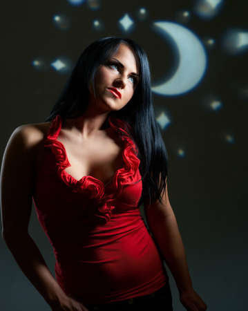 Artistic portrait of beautiful young brunette over artificial night sky photo