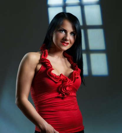 Artistic portrait of beautiful young brunette, studio shot photo