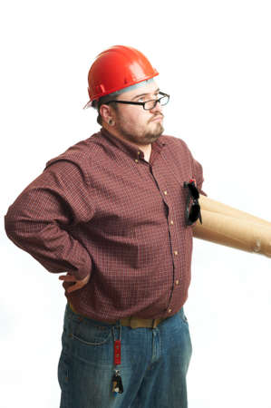 Serious builder in glasses and red hard hat with engineering drawing isolated on white photo