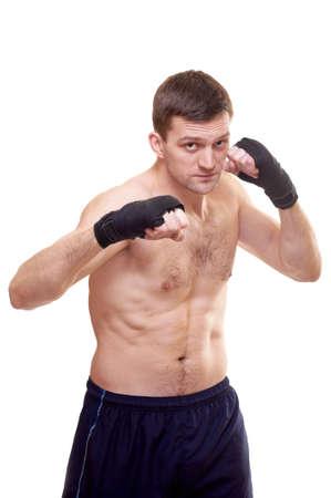 jab: Portrait of a kick boxer isolated on white Stock Photo