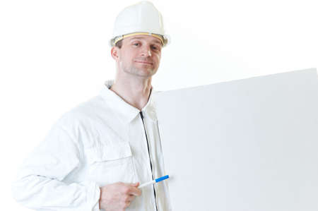 Smiling builder man with blank and pen in hemlet  isolated on white photo