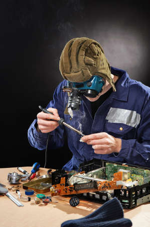 Crazy funny genious with soldering iron Standard-Bild