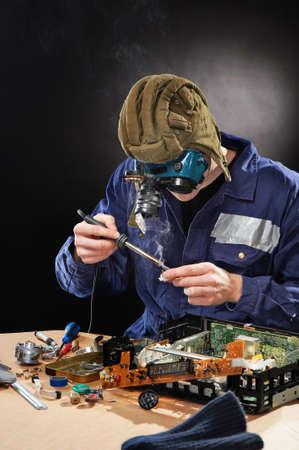 Crazy funny genious with soldering iron Zdjęcie Seryjne
