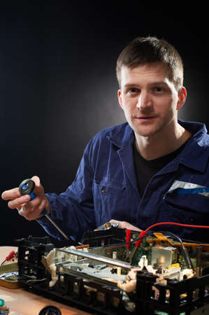 Handsome repairing man with screwdrivers Stock Photo