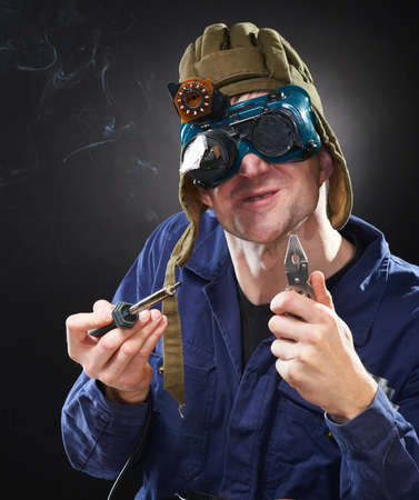 Crazy funny genious with soldering iron photo