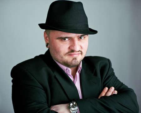 unshaved: Attractive unshaved man in black hat
