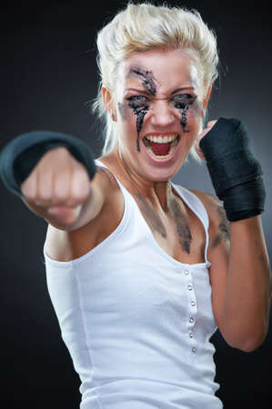 Portrait of a beautiful caucasian boxer girl, studio shot photo