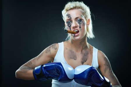 Portrait of a beautiful caucasian boxer girl, studio shot Stock Photo