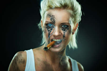cigar smoking woman: Closeup portrait of a beautiful young caucasian punk woman with dirty face and cigar in her mouth