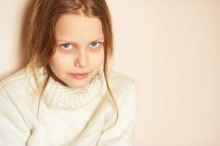 Portrait of a sad blond little girl, shallow DOF Stock Photo - 9156529